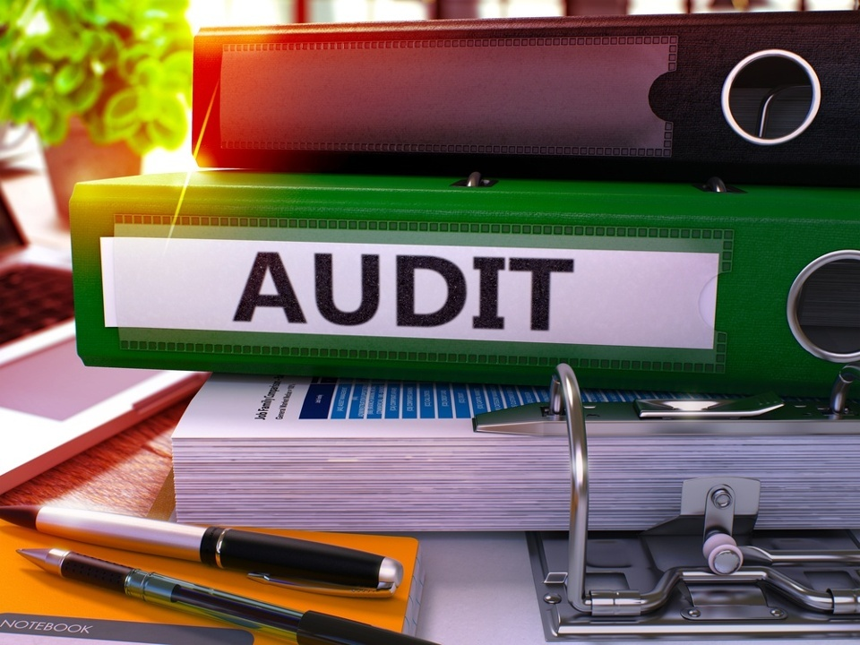 Green Office Folder with Inscription Audit on Office Desktop with Office Supplies and Modern Laptop. Audit Business Concept on Blurred Background. Audit - Toned Image. 3D.jpeg